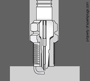 Illustration of a spark plug with a tapered seat installed in the spark plug chamber
