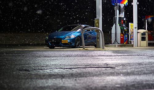 Car at a gas station during winter